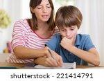 young mother doing homework... | Shutterstock . vector #221414791