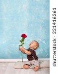 Cute Little Baby Boy Giving...