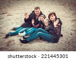 happy family sitting on stony...   Shutterstock . vector #221445301