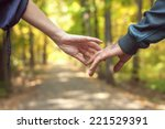 happy couple holding hands when ... | Shutterstock . vector #221529391