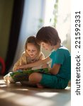 two little cute kids reading a... | Shutterstock . vector #221592331