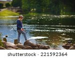 A Young Boy Walking Along The...