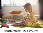 a little cute girl in a yellow... | Shutterstock . vector #221592391