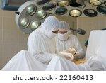 surgeon team at work   Shutterstock . vector #22160413
