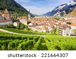 Beautiful view at Swiss town Chur , vineyards and Alps mountains, summertime