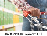 man in dungarees and checked... | Shutterstock . vector #221704594