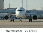 Commercial airliner taxiing at the airport - stock photo