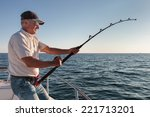fisherman fishing from the boat | Shutterstock . vector #221713201