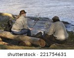 senior couple sitting by camp... | Shutterstock . vector #221754631
