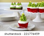Cupcakes decorated with Christmas trees - stock photo