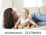 mother with her baby playing on ... | Shutterstock . vector #221786041