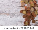 euro coins on a rough wooden... | Shutterstock . vector #221821141