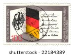 Old canceled german stamp with flag and eagle - stock photo
