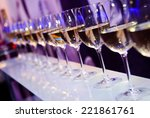 glasses with white wine lit by...   Shutterstock . vector #221861761