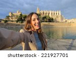Tourist Woman Photographing A...
