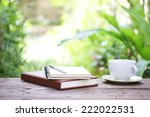 notebook  and coffee on wooden... | Shutterstock . vector #222022531