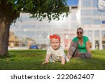 baby crawling on the grass on a ... | Shutterstock . vector #222062407