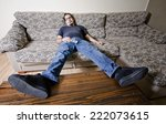 adult man resting in sofa like... | Shutterstock . vector #222073615