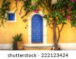 Yellow House With Blue Door In...