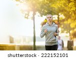 Young Female Runner Is Jogging...