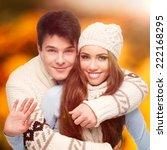 happy young couple standing... | Shutterstock . vector #222168295