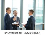 three colleagues talking in... | Shutterstock . vector #222195664