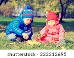 little boy and girl playing... | Shutterstock . vector #222212695