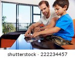 a dad and his son bonding over... | Shutterstock . vector #222234457