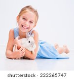 Stock photo cute smiling girl in a blue dress with a white rabbit 222265747