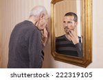 elder man looking a younger... | Shutterstock . vector #222319105