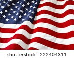 closeup of ruffled american flag | Shutterstock . vector #222404311