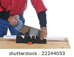 Construction Worker using a saw and miter box - isolated over white - stock photo