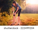 young woman limbering up before ...   Shutterstock . vector #222499204