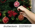 girl hanging decorative toy... | Shutterstock . vector #222550519