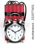 Small photo of alarm clock and sticks of dynamite fashioned into a time bomb