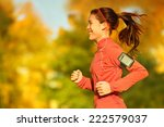 Woman Runner Running In Fall...