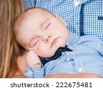 baby sleeps on the hands of... | Shutterstock . vector #222675481
