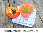 fresh papaya smoothies in glass.   Shutterstock . vector #222695371