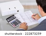 accountant calculating finances.... | Shutterstock . vector #222873259