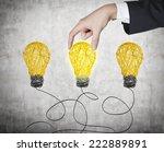 a hand chooses one lightbulb... | Shutterstock . vector #222889891