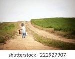 Rear View Of Little Boy Walkin...