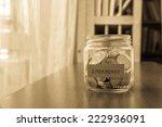a savings money jar with world... | Shutterstock . vector #222936091