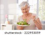 Happy Old Lady Eating Fresh...