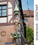 Small photo of NUREMBERG, GERMANY JULY 22 2014: Day view of Albrecht Durer's House in Nuremberg, Germany. Albrecht Durer bought this house in 1509, and lived here until his death in 1528.