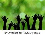 hands up silhouette  | Shutterstock . vector #223044511
