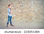 boy thinking over textured... | Shutterstock . vector #223051384