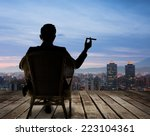 silhouette of businessman sit... | Shutterstock . vector #223104361
