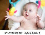 Baby Girl Pulling Hand To Toy