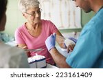 senior woman with bandage on... | Shutterstock . vector #223161409