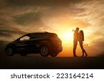 Stock photo silhouette of happiness couple stay near the new car under sky 223164214